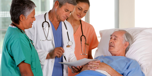 medical team discussing results with patient